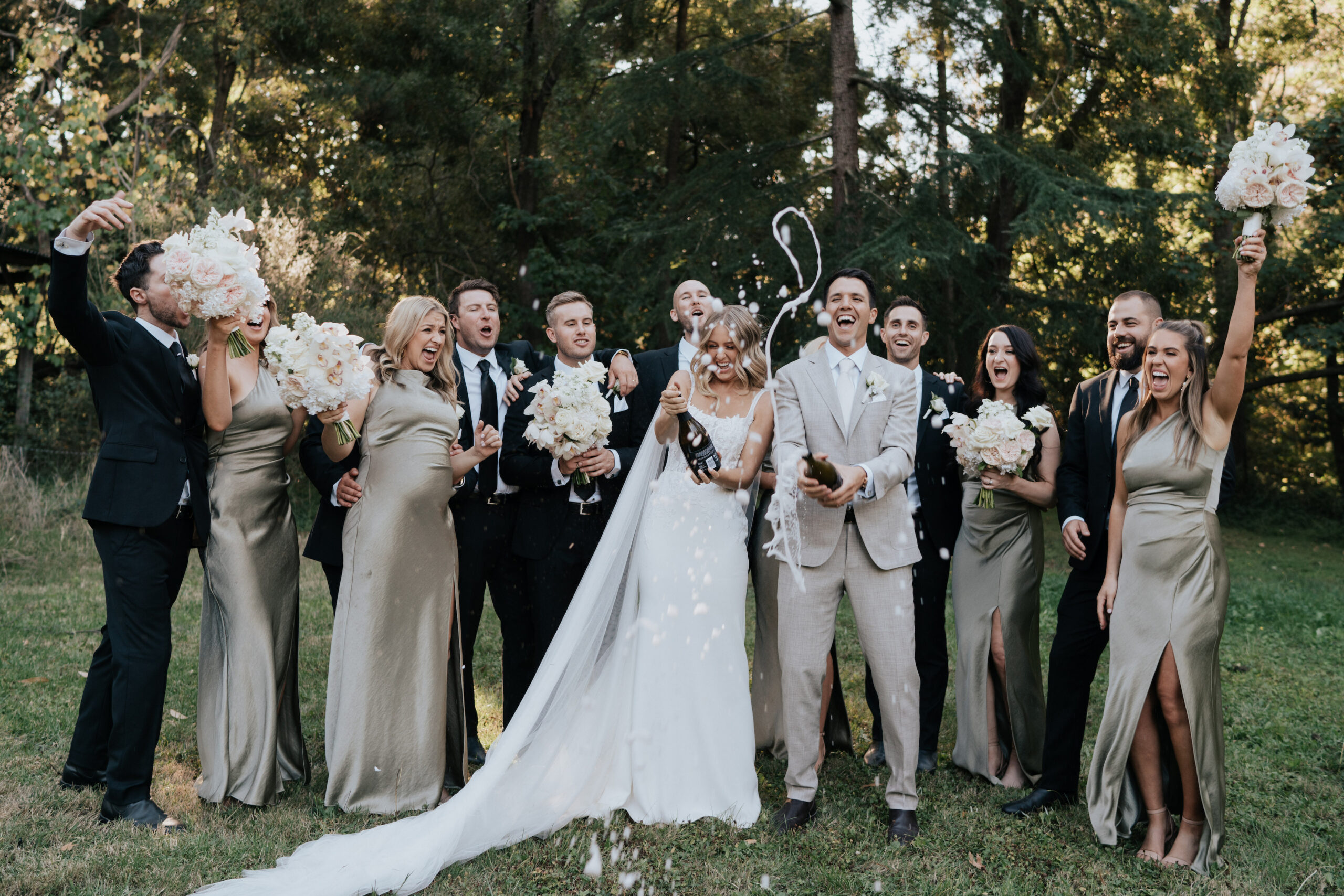 Bridal party popping champagne