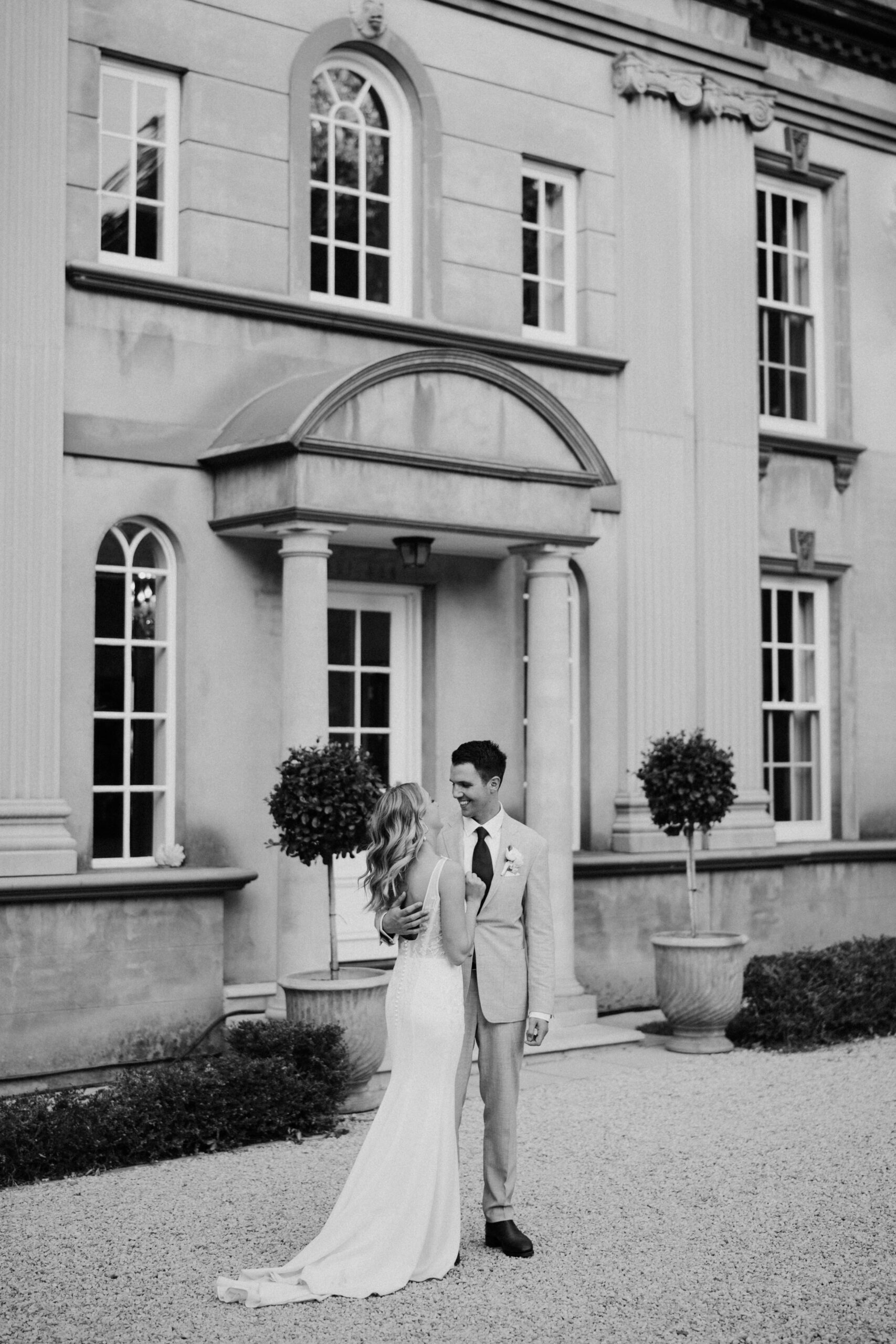 Kayla & Jonathan in front of house