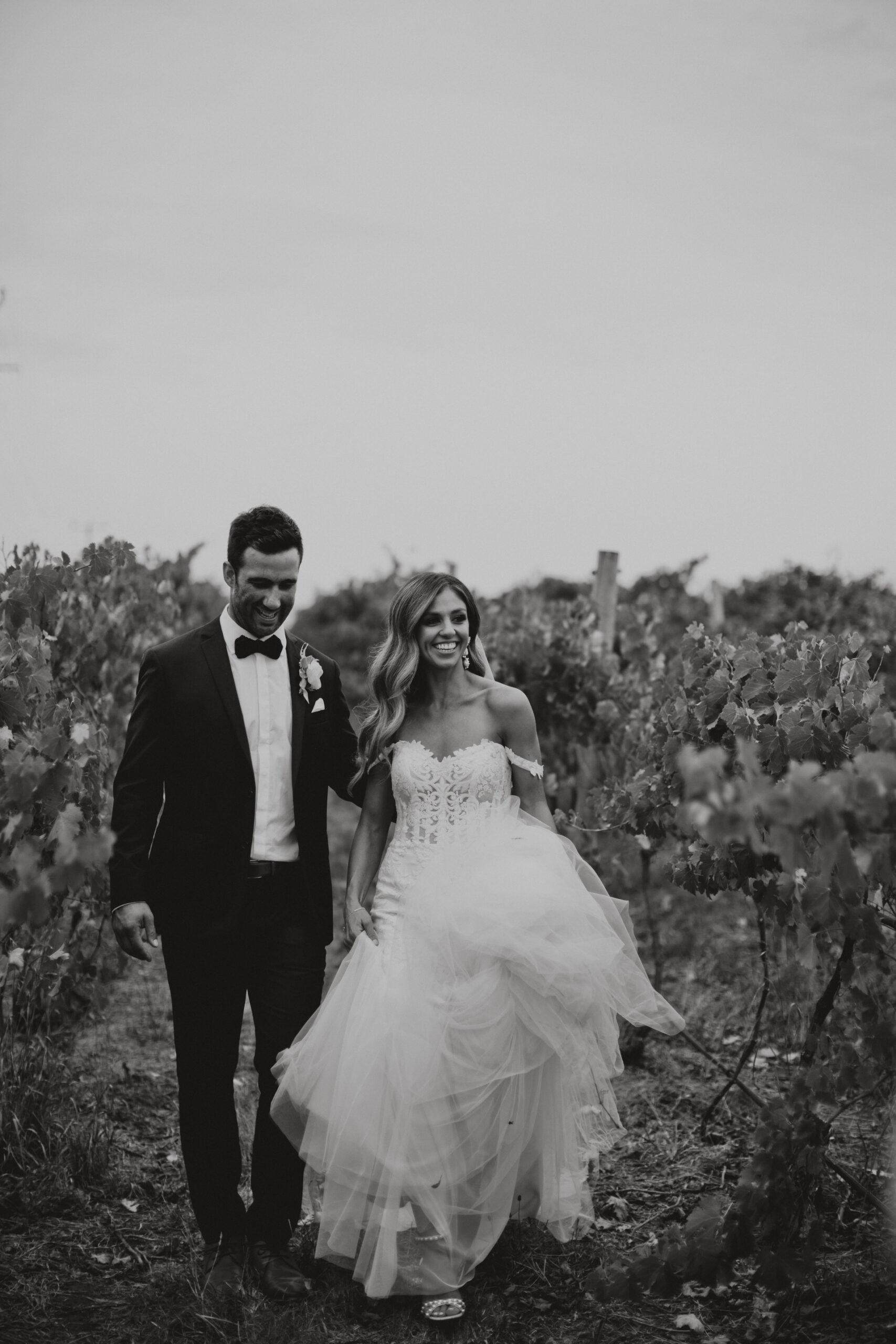 Ashley and Brendan amongst vineyards